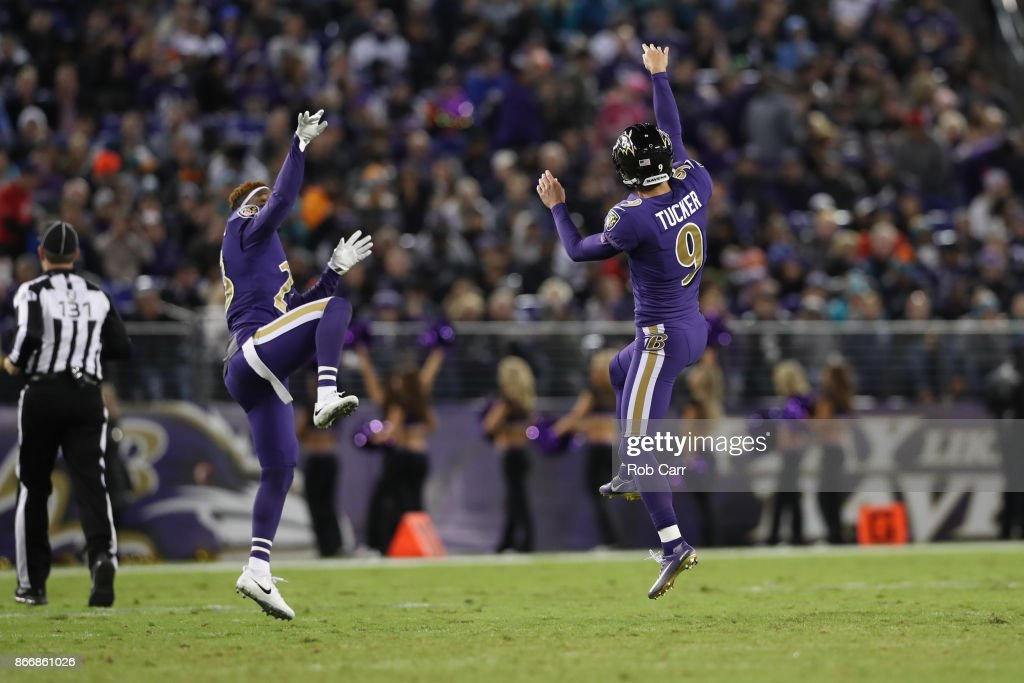 Kicker Justin Tucker #9 and strong safety Tony Jefferson #23 of the Baltimore Ravens celebrate after a field goal in the second quarter against the Miami Dolphins at M&T Bank Stadium on October 26, 2017 in Baltimore, Maryland.