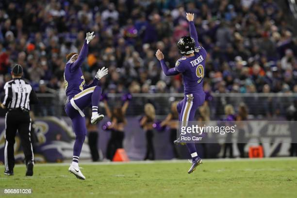 Kicker Justin Tucker and strong safety Tony Jefferson of the Baltimore Ravens celebrate after a field goal in the second quarter against the Miami...