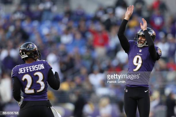 Kicker Justin Tucker and strong safety Tony Jefferson of the Baltimore Ravens celebrate after a field goal in the fourth quarter against the Detroit...