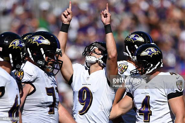 Kicker Justin Tucker of the Baltimore Ravens celebrates a field goal in the fourth quarter against the Cincinnati Bengals at MT Bank Stadium on...