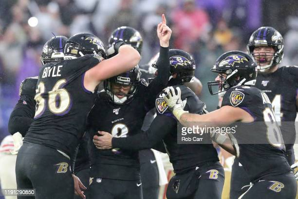 Kicker Justin Tucker of the Baltimore Ravens celebrates after hitting the game winning field goal against the San Francisco 49ers at M&T Bank Stadium...