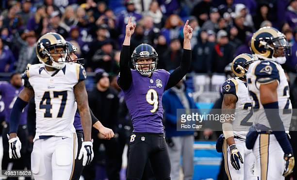 Kicker Justin Tucker of the Baltimore Ravens celebrates after hitting the game winning kick to give the Ravens a 1613 win over the St Louis Rams at...