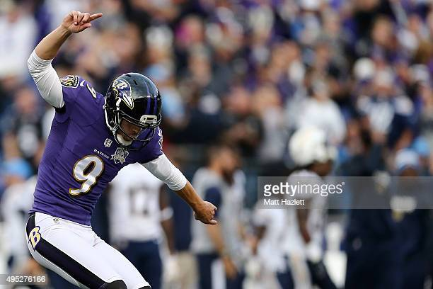Kicker Justin Tucker of the Baltimore Ravens celebrates after kicking the game winning field goal in the fourth quarter to defeat the San Diego...