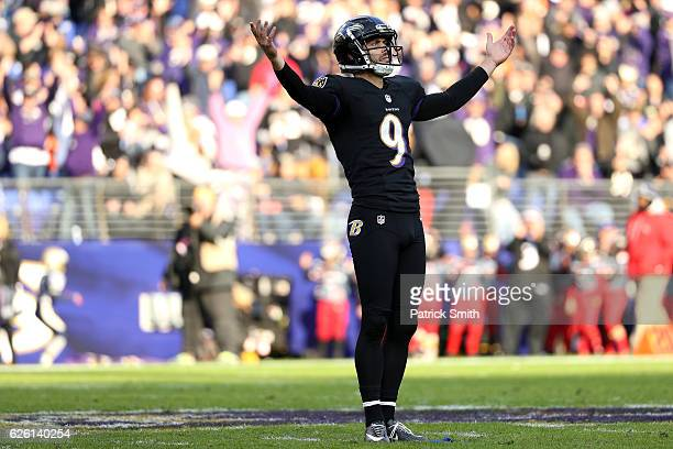 Kicker Justin Tucker of the Baltimore Ravens celebrates after kicking a field goal in the second quarter against the Cincinnati Bengals at MT Bank...