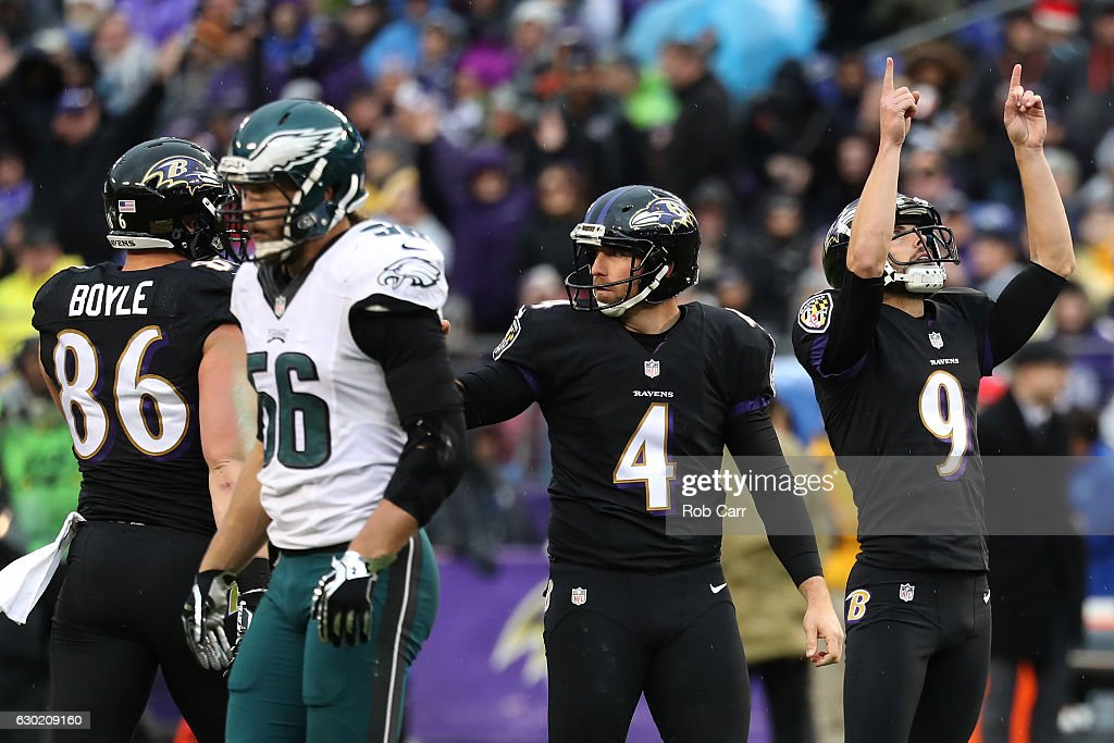 Kicker Justin Tucker #9 of the Baltimore Ravens celebrates with teammates punter Sam Koch #4 and tight end Nick Boyle #86 after kicking a second quarter touchdown against the Philadelphia Eagles at M&T Bank Stadium on December 18, 2016 in Baltimore, Maryland.