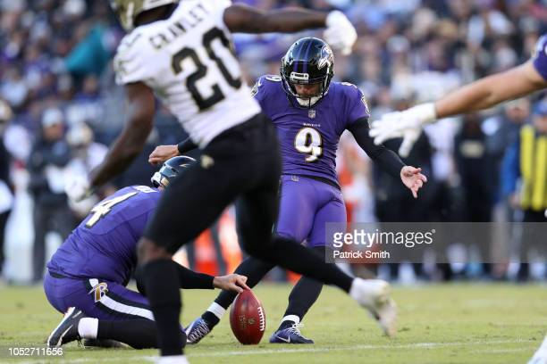 Kicker Justin Tucker of the Baltimore Ravens kicks a field goal in the second quarter against the New Orleans Saints at MT Bank Stadium on October 21...