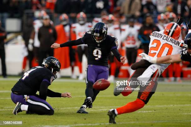 Kicker Justin Tucker of the Baltimore Ravens kicks a field goal in the first quarter against the Cleveland Browns at MT Bank Stadium on December 30...