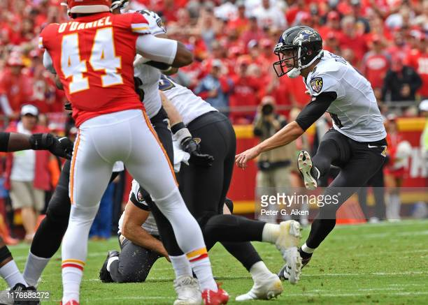 Kicker Justin Tucker of the Baltimore Ravens kicks a field goal against the Kansas City Chiefs during the second half at Arrowhead Stadium on...