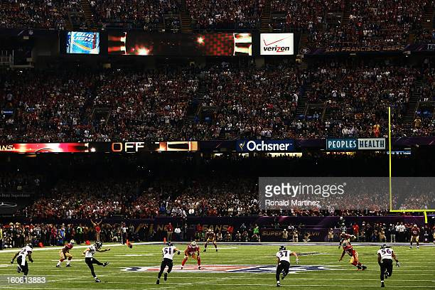 Kicker Justin Tucker of the Baltimore Ravens kicks the opening kickoff to the San Francisco 49ers during Super Bowl XLVII at the MercedesBenz...