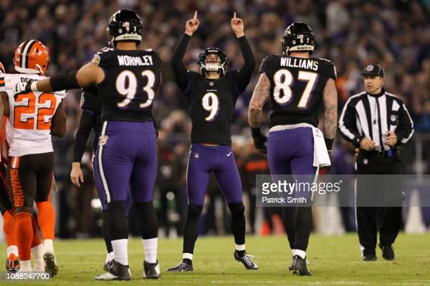 Kicker Justin Tucker of the Baltimore Ravens reacts after a field goal in the second quarter against the Cleveland Browns at MT Bank Stadium on...