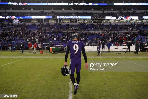 Kicker Justin Tucker of the Baltimore Ravens runs off the field after New Orleans Saints wins 2423 at MT Bank Stadium on October 21 2018 in Baltimore...