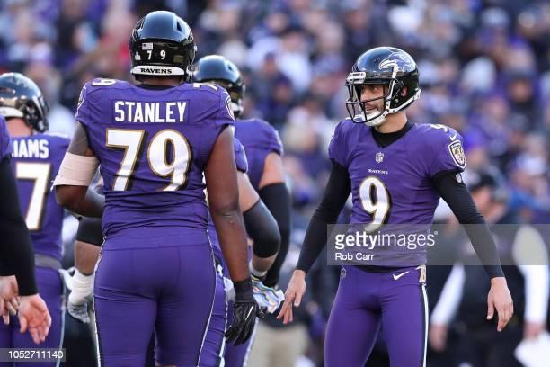 Kicker Justin Tucker of the Baltimore Ravens stands on the field after kicking a field goal in the second quarter against the New Orleans Saints at...