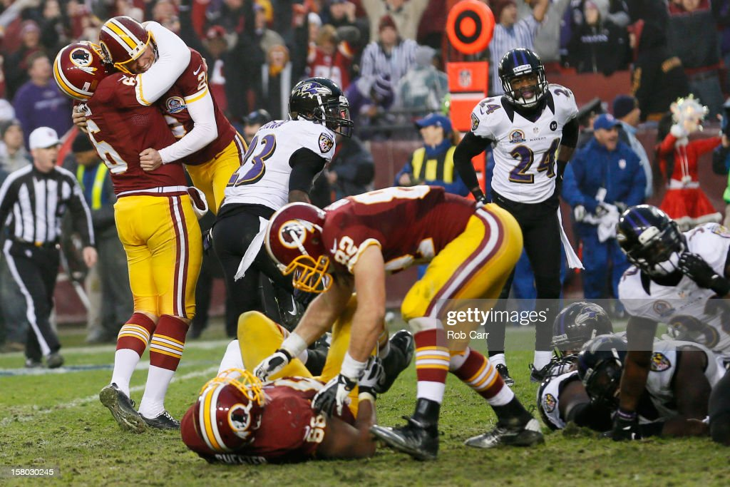 Kicker Kai Forbath #2 of the Washington Redskins celebrates with holder Sav Rocca #6 after hitting the game winning field goal in overtime to give the Redskins a 31-28 win over the Baltimore Ravens at FedExField on December 9, 2012 in Landover, Maryland.