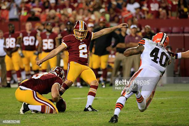 Kicker Kai Forbath of the Washington Redskins kicks an extra point against the Cleveland Browns during a preseason game at FedExField on August 18...