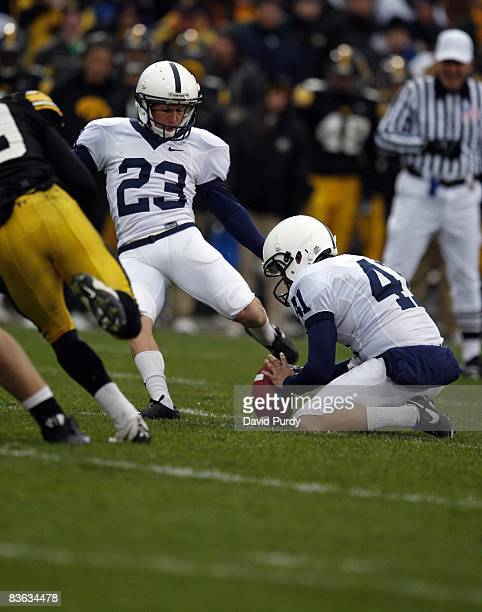 Kicker Kevin Kelly of the Penn State Nittany Lions kicks a field goal as Jeremy Boone holds the ball on the play against the Iowa Hawkeyes at Kinnick...