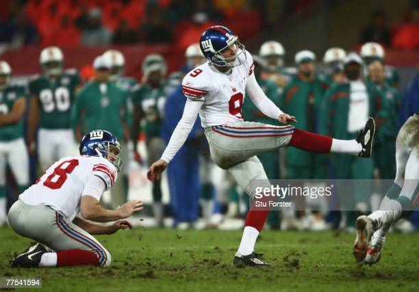 Kicker Lawrence Tynes of the Giants kicks the extra point during the NFL Bridgestone International Series match between New York Giants and Miami...