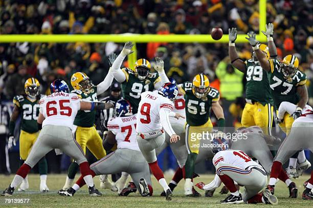 Kicker Lawrence Tynes of the New York Giants kicks a game winning 47-yard field goal to win the NFC championship game against the Green Bay Packers...