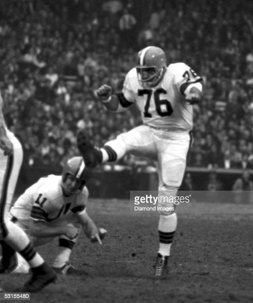 Kicker Lou Groza of the Cleveland Browns follows through on a kick during the game on November 15 1964 against the Detroit Lions at Municipal Stadium...