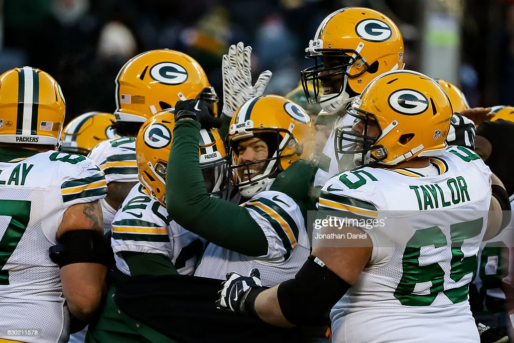 Kicker Mason Crosby #2 of the Green Bay Packers celebrates after winning the game with a 32 yd field goal against the Chicago Bears in the fourth quarter at Soldier Field on December 18, 2016 in Chicago, Illinois.