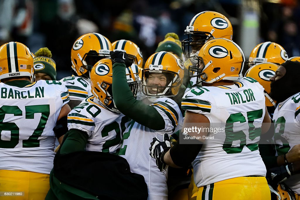 Kicker Mason Crosby #2 of the Green Bay Packers (middle) celebrates after winning the game with a 32 yd field goal against the Chicago Bears in the fourth quarter at Soldier Field on December 18, 2016 in Chicago, Illinois. The Green Bay Packers defeated the Chicago Bears 30-27.