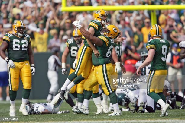 Kicker Mason Crosby of the Green Bay Packers jumps into the arms of guard Tony Palmer after kicking the game winning field goal during the game...