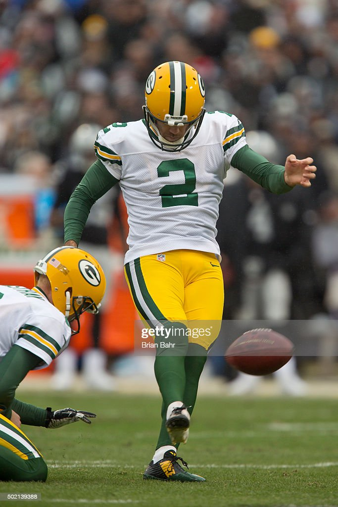 Kicker Mason Crosby #2 of the Green Bay Packers scores a point after a touchdown against the Oakland Raiders on December 20, 2015 at O.co Coliseum in Oakland, California. The Packers won 30-20.