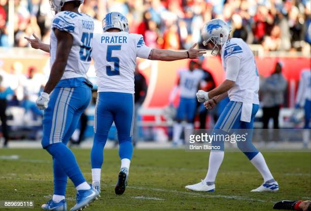 Kicker Matt Prater of the Detroit Lions celebrates with punter Sam Martin following his 46yard gamewinning field goal during the fourth quarter of an...