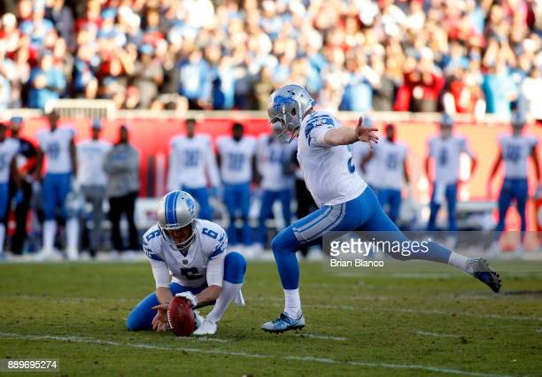 Kicker Matt Prater of the Detroit Lions gets a hold from punter Sam Martin as he kicks the 46yard gamewinning field goal during the fourth quarter of...