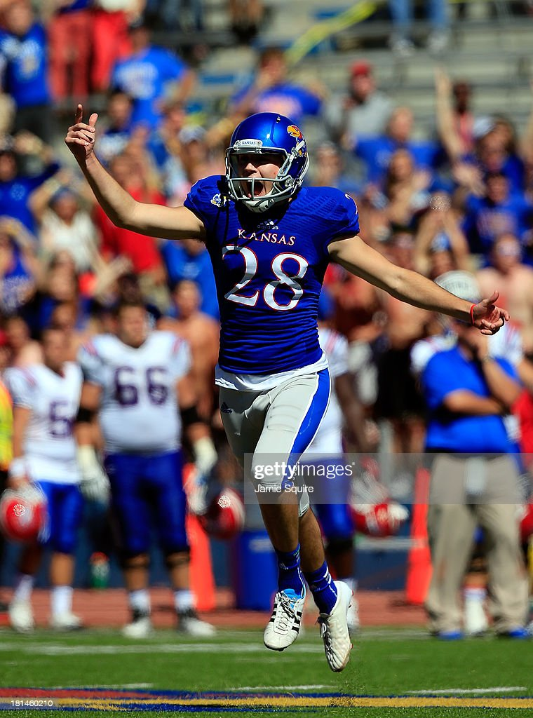 Kicker Matthew Wyman #28 of the Kansas Jayhawks reacts after kicking the game-winning field goal in the final seconds as the Jayhawks defeated the Louisiana Tech Bulldogs 13-10 turnover win the game at Memorial Stadium on September 21, 2013 in Lawrence, Kansas.