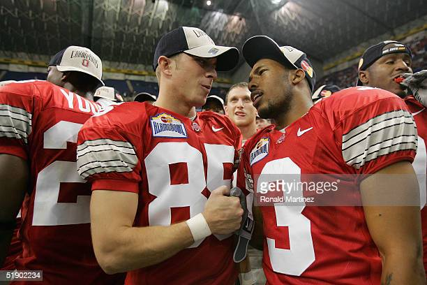 Kicker Mike Nugent and flanker Bam Childress of the Ohio State Buckeyes celebrate after defeating the Oklahoma State Cowboys 337 during the...
