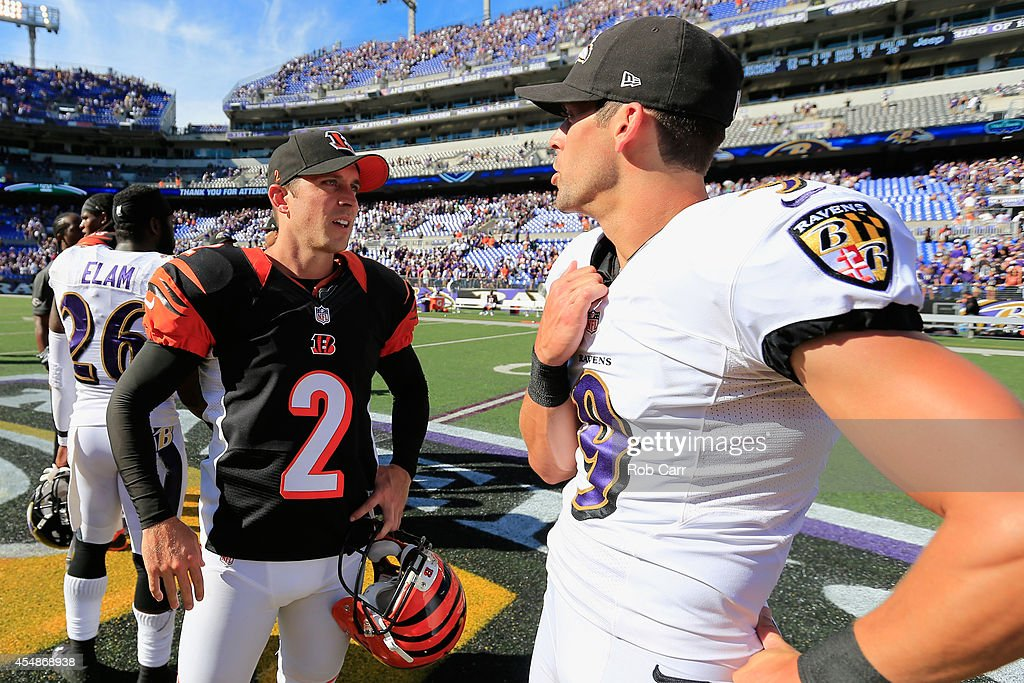 Kicker Mike Nugent #2 of the Cincinnati Bengals speaks with kicker Justin Tucker #9 of the Baltimore Ravens after the Cincinnati Bengals defeated the Baltimore Ravens 23-16 at M&T Bank Stadium on September 7, 2014 in Baltimore, Maryland.