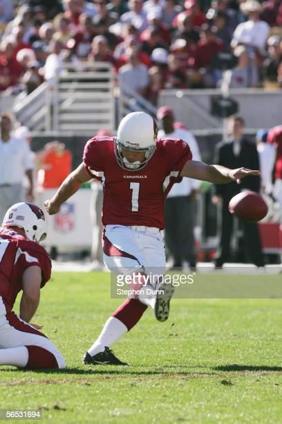 Kicker Neil Rackers of the Arizona Cardinals kicks a field goal against the Philadelphia Eagles at Sun Devil Stadium on December 24 2005 in Tempe...