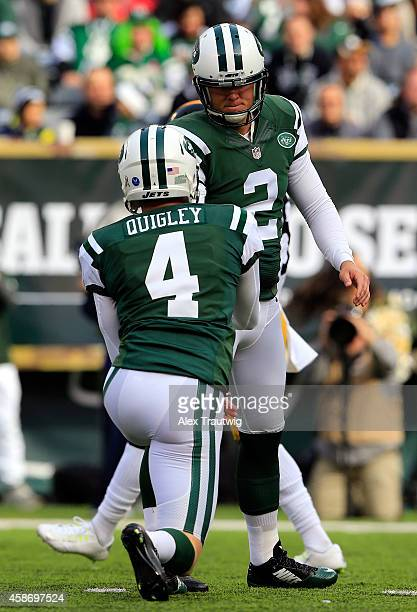 Kicker Nick Folk celebrates with Ryan Quigley of the New York Jets after kicking a field goal in the first quarter against the Pittsburgh Steelers...