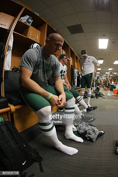 Kicker Nick Folk of the New York Jets prepares in the locker room before the game against the Miami Dolphins on November 6 2016 at Hard Rock Stadium...