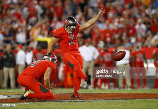 Kicker Nick Folk of the Tampa Bay Buccaneers gets a hold form punter Bryan Anger as he misses a 56yard field goal attempt during the second quarter...