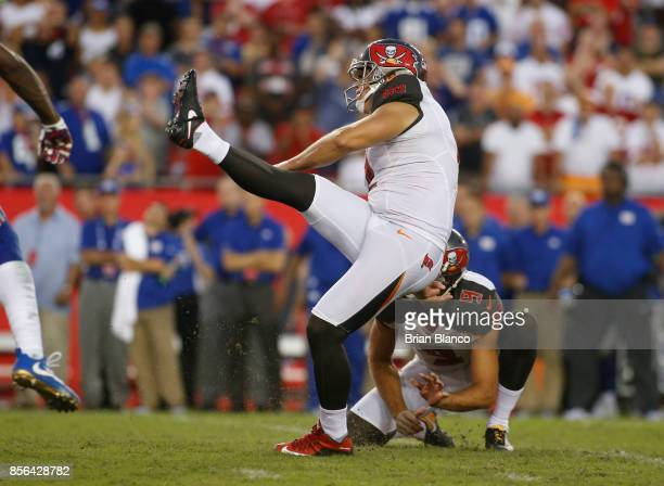 Kicker Nick Folk of the Tampa Bay Buccaneers gets a hold from punter Bryan Anger as he kicks a 34yard field goal to give the Buccaneers the 2523 win...