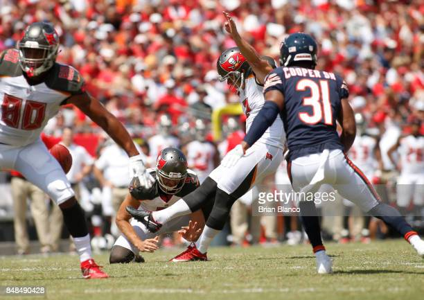 Kicker Nick Folk of the Tampa Bay Buccaneers gets pressure from defensive back Marcus Cooper of the Chicago Bears as he hits a 42yard field goal...