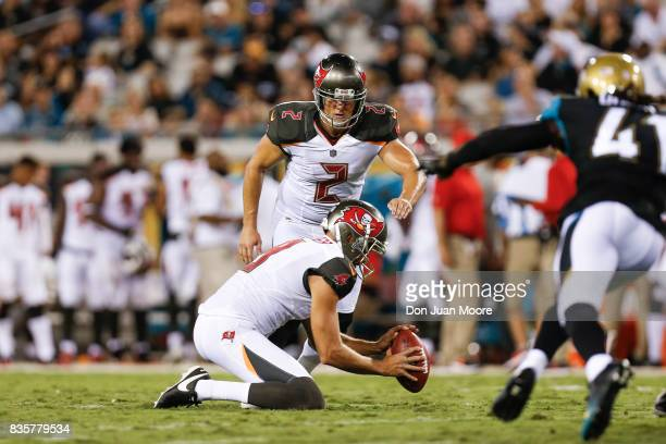 Kicker Nick Folk of the Tampa Bay Buccaneers kicks an extra point after a touchdown during the game against the Jacksonville Jaguars at EverBank...