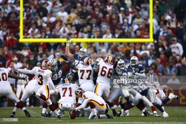 Kicker Nick Novak of the Washington Redskins kicks a game winning 47 yard field goal against the Dallas Cowboys on November 5 2006 at FedEx Field in...