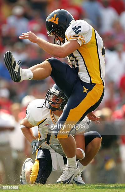 Kicker Pat McAfee of West Virginia kicks an extra point after a touchdown during the second half of the game against Maryland on September 17 2005 at...