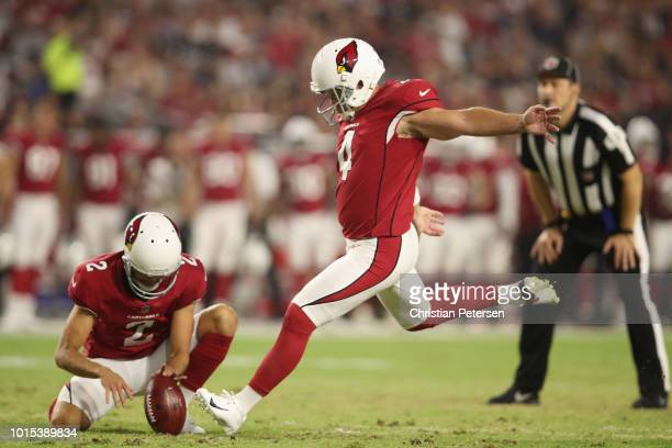 Kicker Phil Dawson of the Arizona Cardinals kicks a extra point held by punter Andy Lee during the preseason NFL game against the Los Angeles...