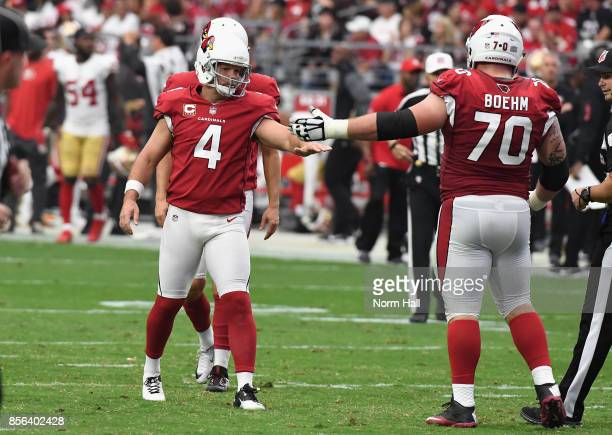 Kicker Phil Dawson of the Arizona Cardinals reacts with teammate offensive guard Evan Boehm after kicking a second quarter field goal during the NFL...