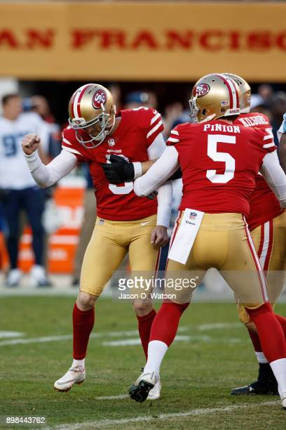 Kicker Robbie Gould of the San Francisco 49ers celebrates with teammates after kicking a game winning field goal against the Tennessee Titans during...