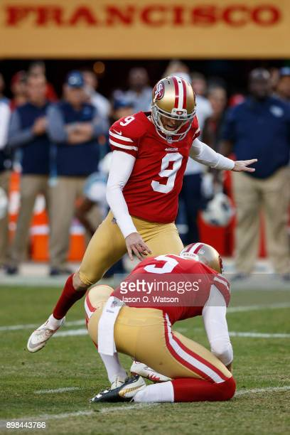 Kicker Robbie Gould of the San Francisco 49ers kicks a game winning field goal on a hold from Bradley Pinion during the fourth quarter against the...