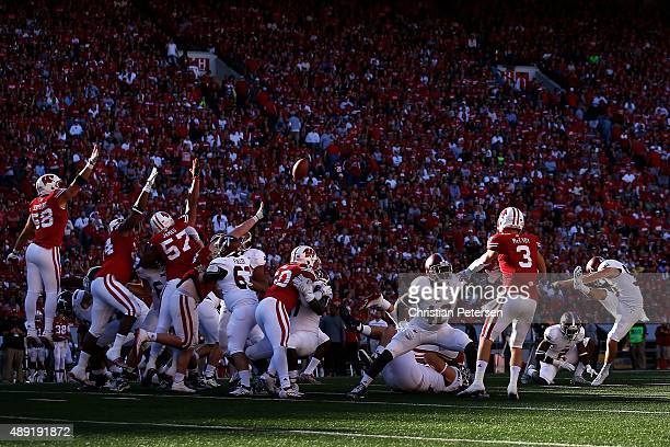 Kicker Ryan Kay of the Troy Trojans attempts an unsuccessful 47 yard field goal against the Wisconsin Badgers during the fourth quarter of the...