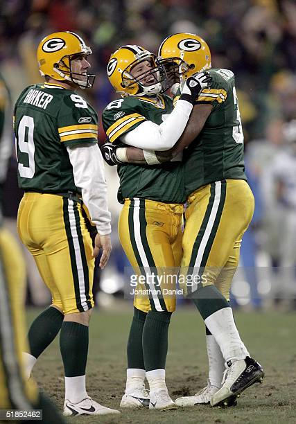 Kicker Ryan Longwell of the Green Bay Packers celebrates his gamewinning field goal with fullback William Henderson and holder Bryan Barker at...