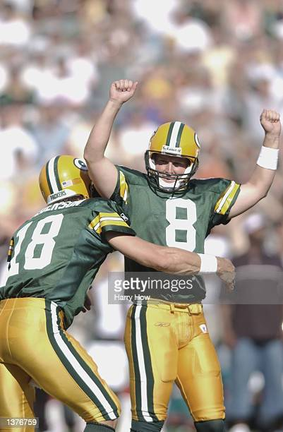 Kicker Ryan Longwell of the Green Bay Packers celebrates with teammate Doug Pederson after his game winning field goal in overtime against the...