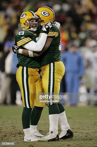 Kicker Ryan Longwell of the Green Bay Packers celebrates with fullback William Henderson during the game against the Detroit Lions at Lambeau Field...