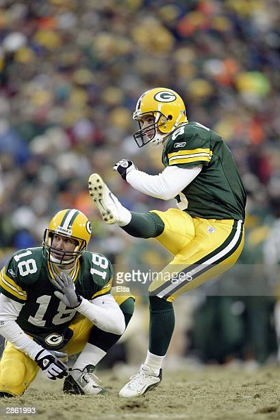 Kicker Ryan Longwell of the Green Bay Packers kicks the ball during the NFC playoff game against the Seattle Seahawks on January 4 2004 in Lambeau...