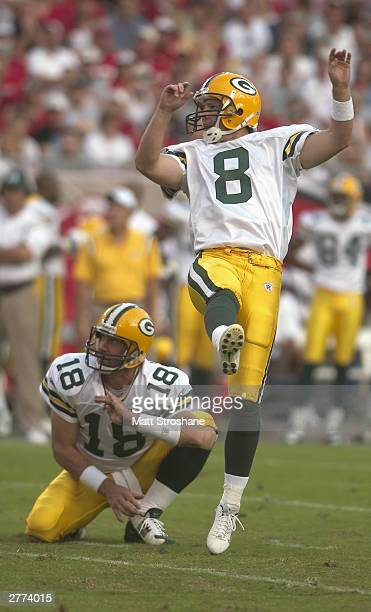 Kicker Ryan Longwell of the Green Bay Packers kicks the football as Doug Pederson holds the ball during the game against the Tampa Bay Buccaneers at...